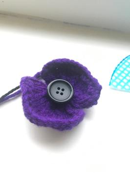 I've had a go at knitting a purple poppy myself - not bad for a first attempt, even if I do say so myself!