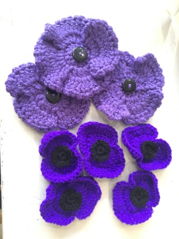 Some of the purple poppies made by members of the public for pinning to Songster's blanket on Remembrance Sunday